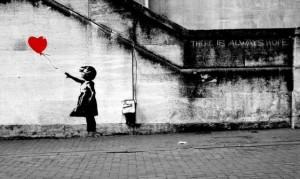 http://design.fanpage.it/banksy-rivisita-la-sua-ragazza-col-palloncino-a-cuore-per-la-siria/